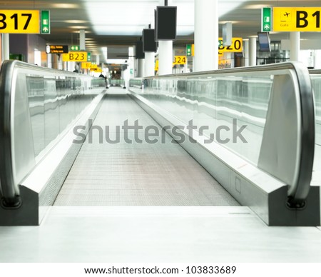 Moving sidewalk at an airport - stock photo