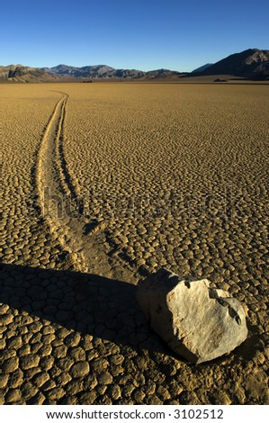 Moving stone in the desert of Death Valley national park, California, USA - stock photo