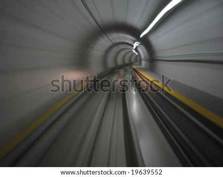 Moving through metro tunnel of Zurich Airport, Switzerland - stock photo