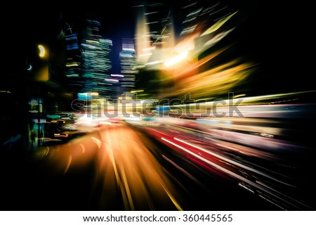 Moving through modern city street with illuminated skyscrapers. Hong Kong. Abstract cityscape traffic background with motion blur, art toning