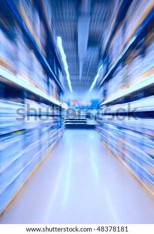 Moving through the shelves - intentional blur - stock photo