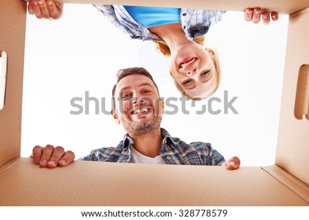 moving to a new apartment. Happy family couple and a lot of cardboard boxes. - stock photo