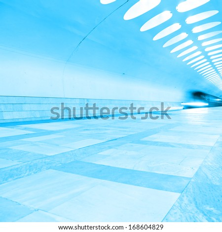 Moving train at subway station. - stock photo