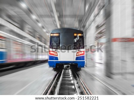Moving train in maintenance workshop with motion blur - stock photo