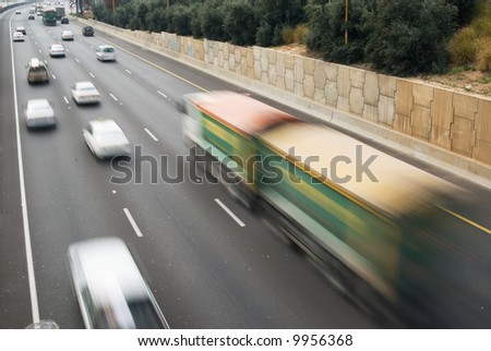 Moving truck, image with motion blur - stock photo