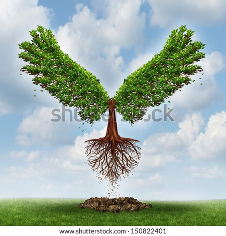 Moving up and the power of success as a growing  tree in the shape of wings that has emerged out of the ground taking flight upward to opportunity as a business concept of successful leadership. - stock photo