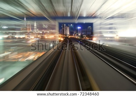 moving urban night transport ,the city of kuala kumpur - stock photo