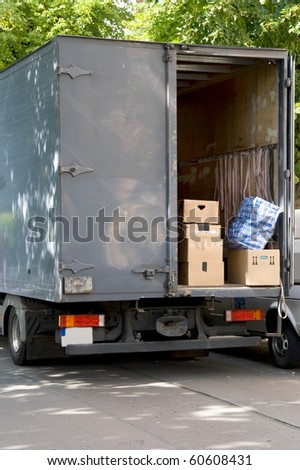 moving van with moving boxes - stock photo