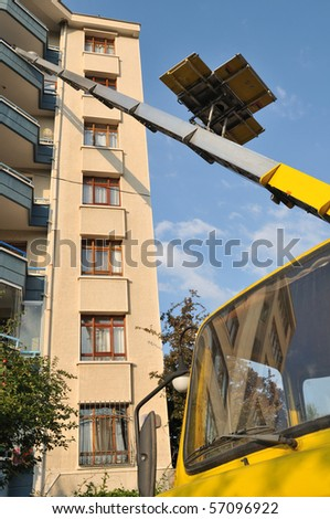 Moving vehicle with lift carrying furniture up and down. - stock photo