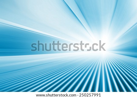 Moving walkway in motion blur and light on background. - stock photo