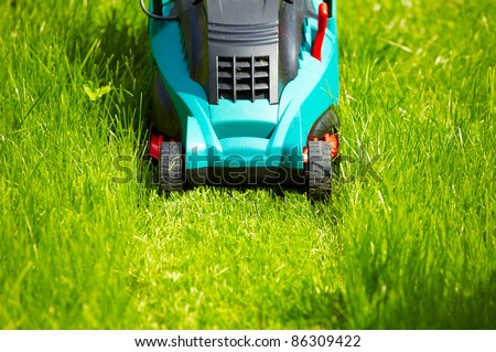 Mowing the lawn with new modern mower