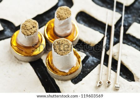 Moxa cones and acupuncture needles - stock photo