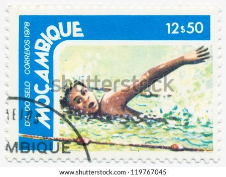 MOZAMBIQUE - CIRCA 1978: A stamp printed in Mozambique, shows swimming, circa 1978 - stock photo