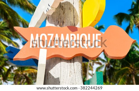 Mozambique welcome sign with palm trees - stock photo