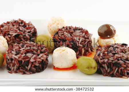 mozarella cheese and dark rice served on plate