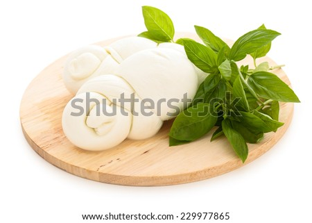 Mozzarella and basil on cutting board. Isolated on white background. - stock photo