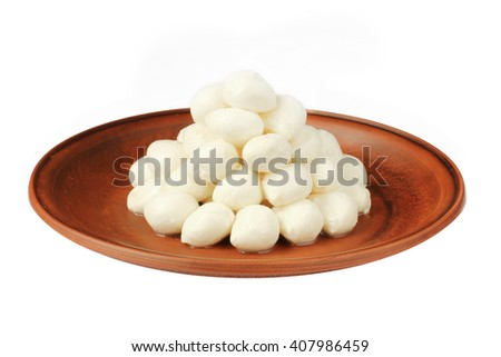 Mozzarella baby on plate isolated - stock photo