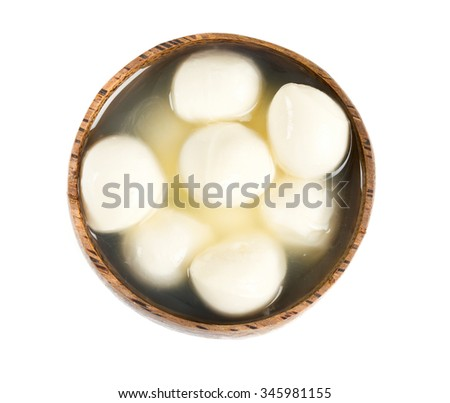 mozzarella balls in a wooden bowl - stock photo