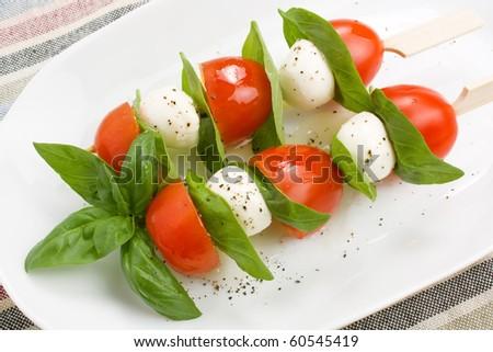 Mozzarella, basil and cherry tomatoes kebab close-up - stock photo