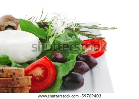 mozzarella cheese and tomatoes over white plate - stock photo