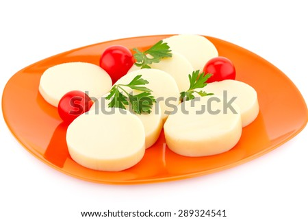 Mozzarella cheese with tomato and parsley on the plate. - stock photo