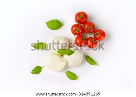 mozzarella, cherry tomatoes and fresh basil - ingredients for caprese salad - stock photo