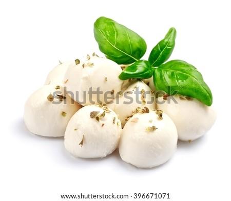 Mozzarella isolated on white background with basil. - stock photo