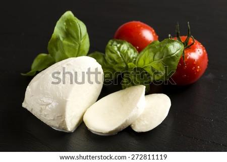 Mozzarella with tomatoes and fresh basil - stock photo