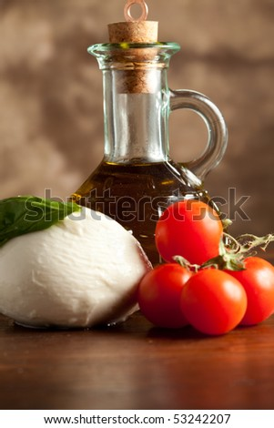 Mozzarella with tomatoes and Oil