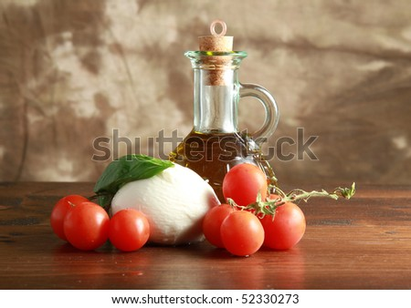 mozzarella with tomatoes, oil and basil
