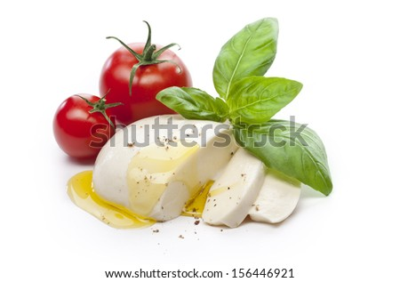 Mozzarella with tomatos and basil leaves isolated - stock photo