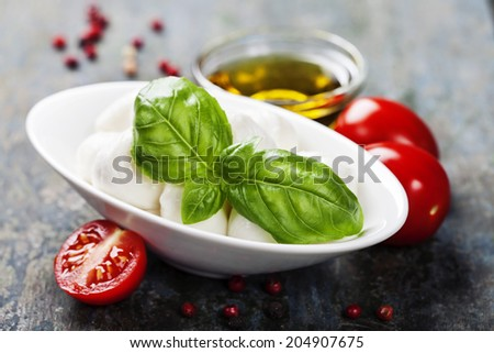 Mozzarella with tomatos and basil leaves  on Wooden background - stock photo