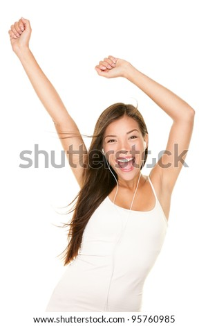 MP3 music player woman. Girl dancing happy and joyful listening to music wearing earphones. Portrait of beautiful cheerful mixed race Chinese Asian / Caucasian female model dancing on white background - stock photo