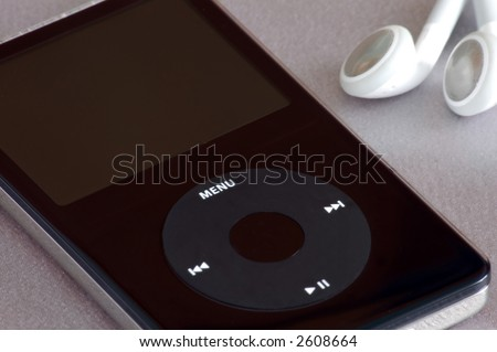 mp3 player and ear buds - stock photo