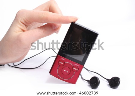 Mp3 player in hand isolated on white background - stock photo