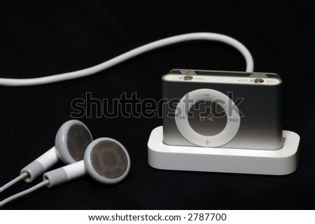 mp3 player on dock charging - stock photo