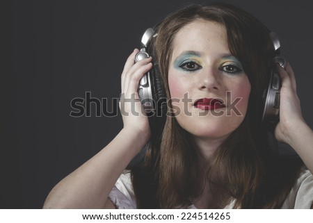 Mp3, young girl listening music with huge headphones - stock photo