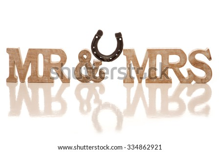 Mr and Mrs block sign with horse shoe cutout - stock photo