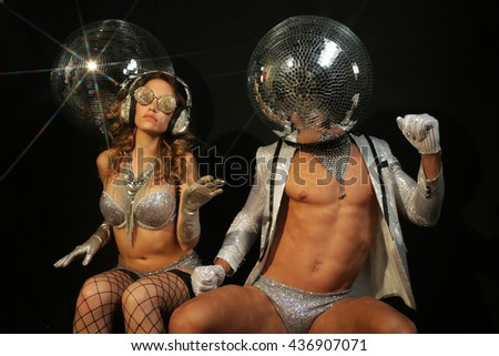 mr and mrs discoball enjoying music. two cool club characters - stock photo