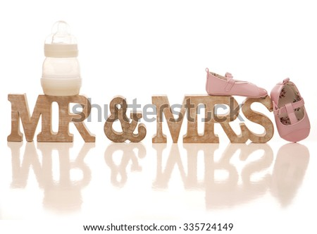 Mr and Mrs expecting a baby sign cutout - stock photo