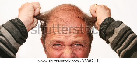Mr Angry pulls his Hair out in frustration - stock photo