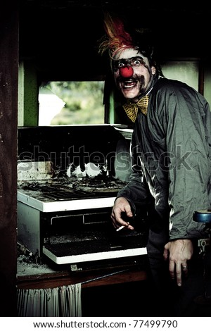 Mr Bungle The Kitchen Clown Stands Next To A Burnt Out Kitchen Stove In A Humorous Display Of Bad Cooking - stock photo