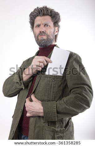 Mr. IceMan, smiling man with a beard, a beard covered with hoarfrost, he holding white card. fashion man in knitted sweater and jacket.  - stock photo