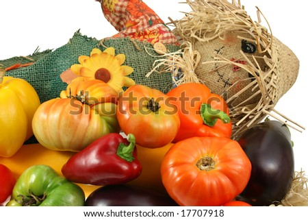 mr. scarecrow with vegetables on white