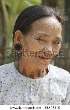 MRAUK U, MYANMAR - December 05: An unidentified Chin tribe tattooed woman posing for a photo on December 05, 2008 in Mrauk U, Myanmar.