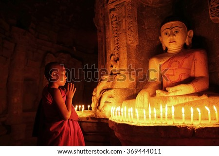 MRAUK U, MYANMAR -JAN 18: Unidentified Buddhism neophyte prays in Andaw Thein temple on January 18, 2016 in Mrauk U, Myanmar. Southeast Asian neophyte praying in a Buddihist temple - stock photo