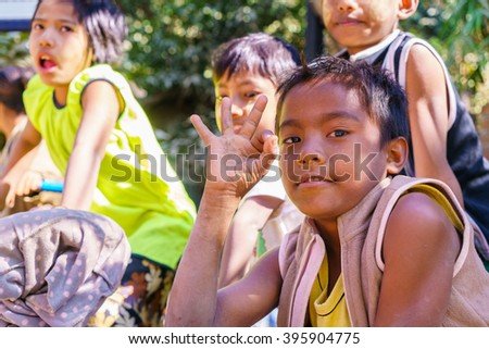 Mrauk-U, MYANMAR - JAN 17: Unidentified young kid on Jan 17, 2016 in Mrauk-U. Myanmar is a source country for children who are subjected to human trafficking, specifically forced labor. - stock photo
