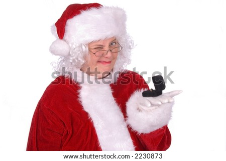 Mrs. Claus winks while holding a ring box - stock photo