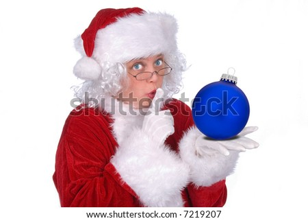 Mrs. Claus with a Christmas ball in her hand isolated over white - stock photo