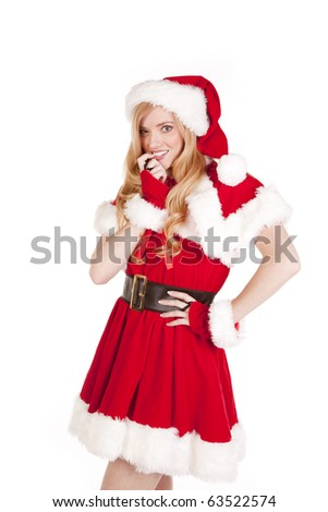 Mrs Santa has a teasing expression on her face. - stock photo